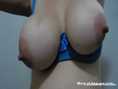 Playing With Massive Round Tits