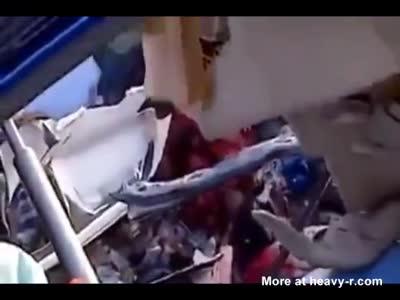 Mangled body removed from crash