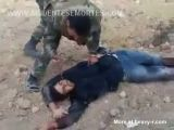 Syrian Soldier Stabbing A Dead Rebel