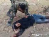 Syrian Soldier Stabbing A Dead Rebel