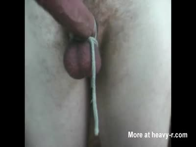 Jerking tied cock to hard