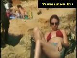 Girl masturbating on beach