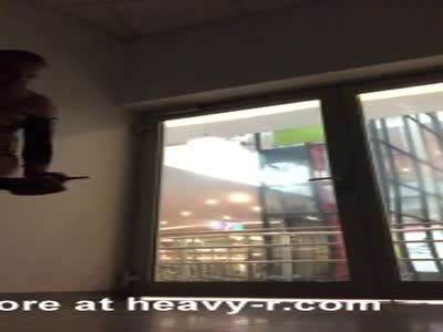 Public wanking cock with high heels in shopping center