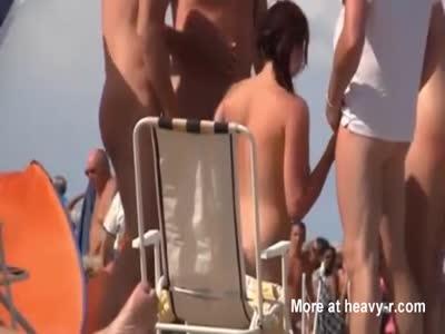 Amateur Sucks Off Random Dudes On The Beach