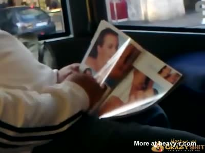 Pervert Enjoying A Porn Magazine On The Bus
