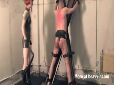 Mistress whips and interrogates slave