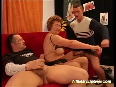 Mature Sucking Two Young Cocks