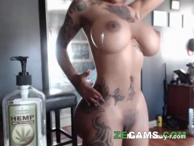Busty Inked Babe Teasing