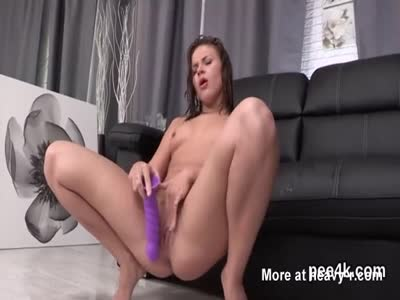 Exquisite chick is peeing and finger fucking shaven snatch