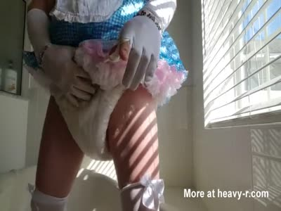diapered sissybaby in pretty blue dress pissing in diapers