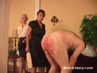Slave paddled by two Mistresses