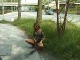 Hot girl pees on the sidewalk