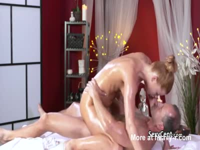 Oiled Redhead Rides On Massage Table