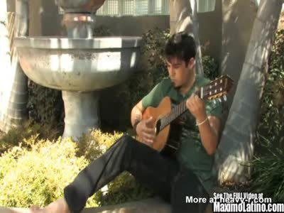 Guitar playing latino Jonny strokes his beautiful cock