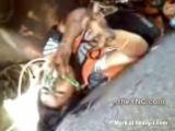 Woman stuck under truck wheels