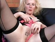 Huge Ring Through Her Pierced Mature Pussy Li...