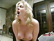 Mature Blonde Woman Smiles And Groans While D...