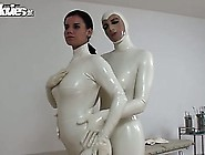 Naughty Babes In White Latex Fondling Each Ot...