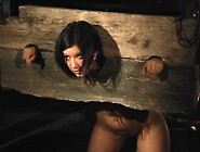 Teen Damsel Restrained In A Wooden Yoke And P...