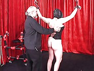 Spread-Eagled Shackled Woman In Leather Mask ...