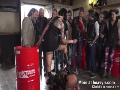 Brunette slave fucks in bikers shop