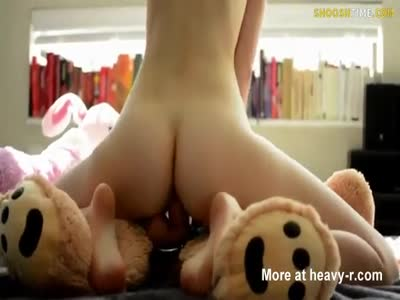 Girl Riding Teddy Bear