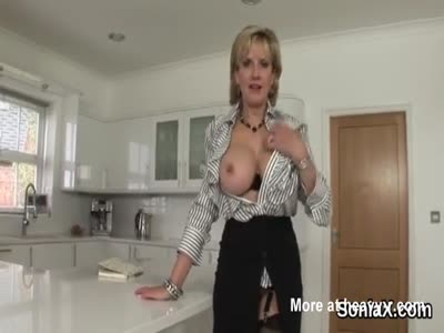 Mature Lady Teasing And Undressing