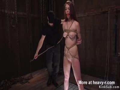 Shaved brunette in rope sucks big cock