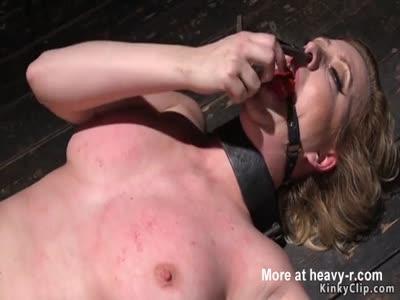 Big tits slave in doggy device bondage