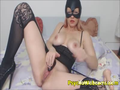Cat Woman In Stockings And High Heels Toying