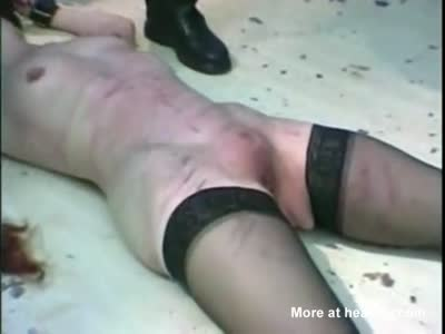 Restrained Slave Caned On The Floor