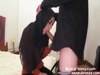 Arab chick is worried to lose her hijab when sucking cock