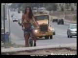 Bikini babe on bicycle gets sharked