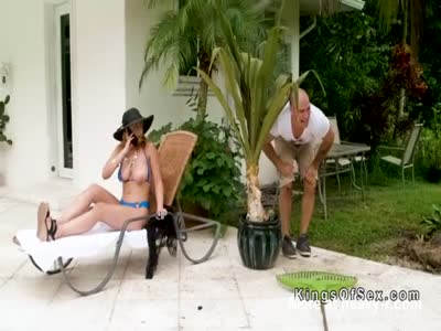 Gardener pouring oil to busty blonde Milf