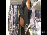 Woman pisses in shop
