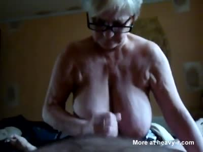 Granny With Big Tits Sucking Cock