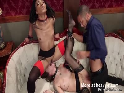 Ebony slave gets iniciation in threesome