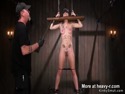 Babe with head in stock gets whipped