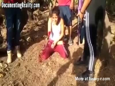 Young Girl Dismembered Alive and Beheaded