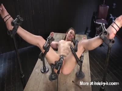 Slave Bound In Metal Bondage Device