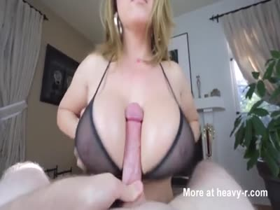 Busty MILF Giving Titjob