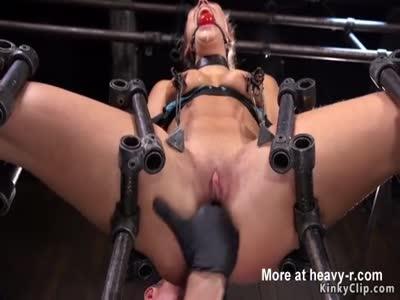 Brunette with split legs in device bondage