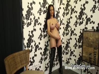Mature tgirl plays with toys solo