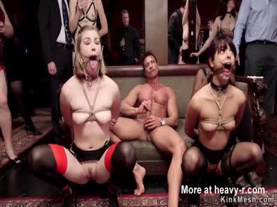 Tied up slaves sucking big cock at orgy