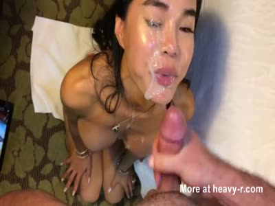 Hot asian milf getting huge facial from white guy