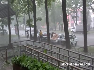 Lady Desperately Tries To Protect Her Car From Hail Storm