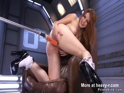 Long haired redhead fucking machine
