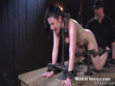 Brunette In Metal Device Gets Ass Whipped