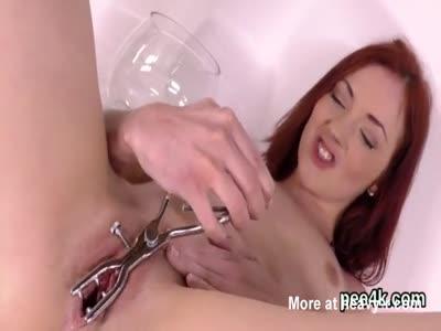 Ravishing Redhead Pissing And Toying