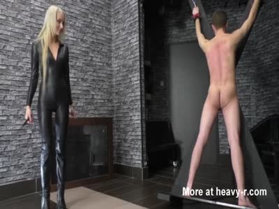 Sadistic Dominatrix Whipping Slave